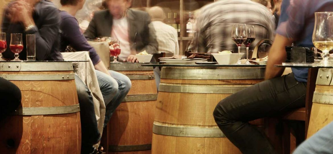 The best restaurants in Barcelona - Shows a busy restaurant with barrel tables