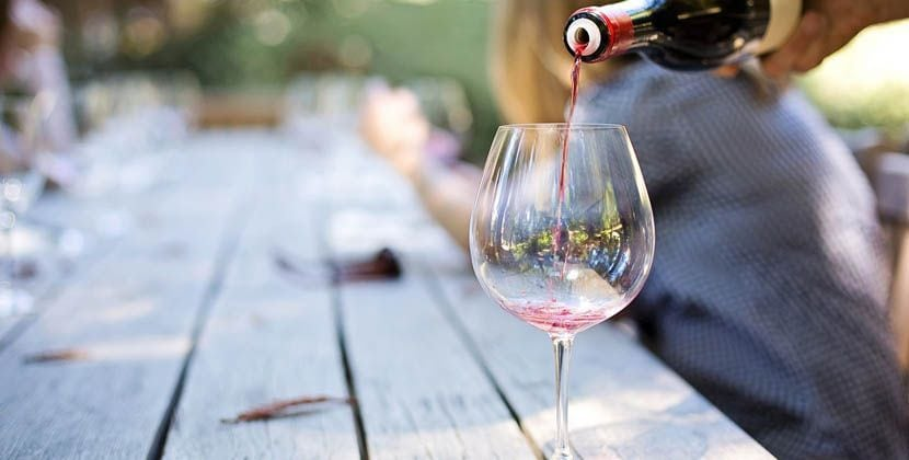 Shows wine tasting - wine being poured into a glass