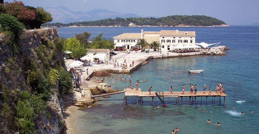 Shows a busy beach in Corfu
