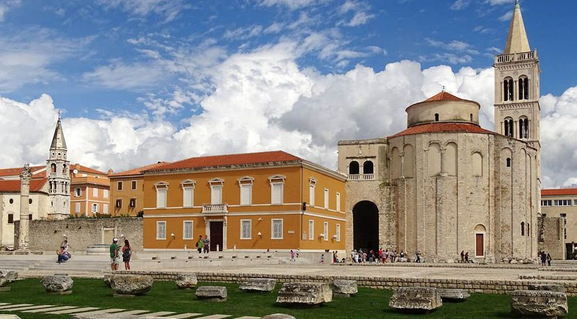 Where to go in Croatia - Shows an old bell tower and Roman ruins in the city centre