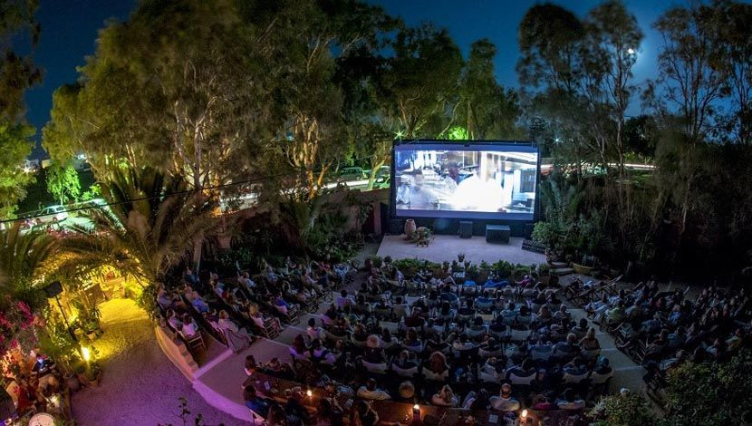 Shows an outdoor movie theatre in Santorini