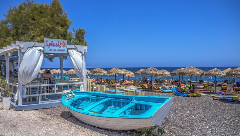 Shows a busy beach in Santorini