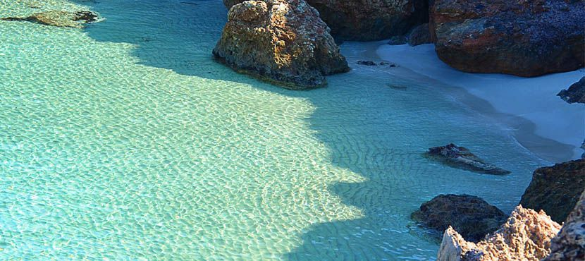 Shows a turquoise lagoon