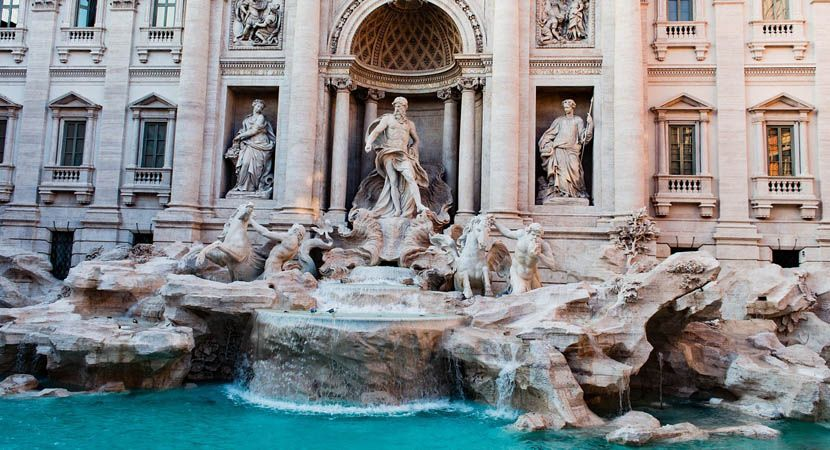 Shows the Trevi Fountain in Rome