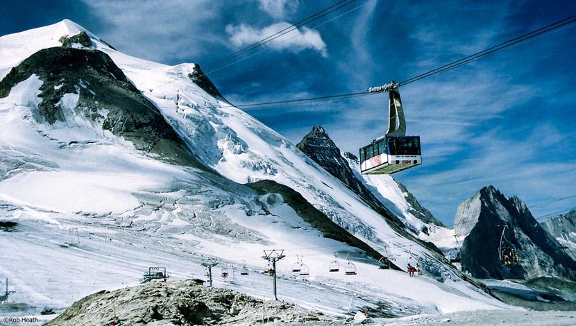 The best ski resorts in France - Shows a cable car over Tignes ski resort