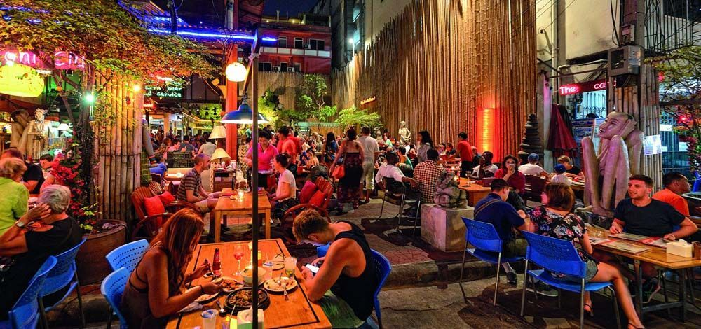 Shows travellers eating on Khao San Road
