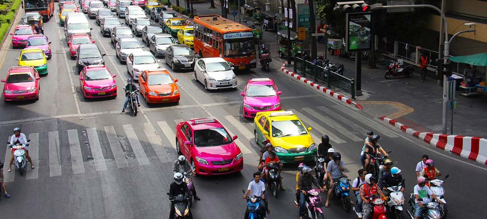 Safety - Shows a busy main road in Bangkok