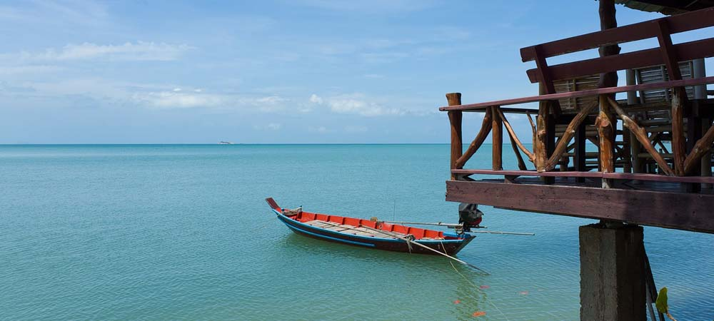 Thailand Travel tips - Shows a boat at a sea dock