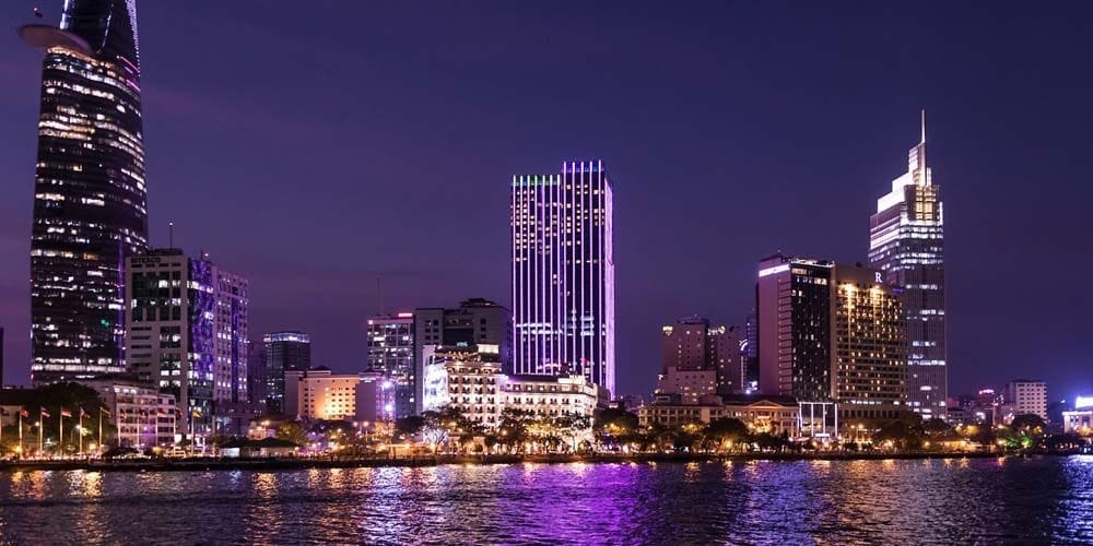 Shows the colourful city of Ho Chi Minh at night - 2 weeks in Vietnam