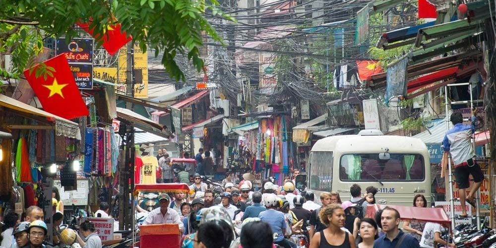Shows the busy streets of Hanoi