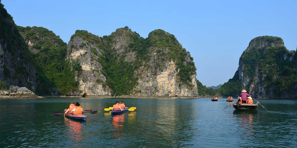 Shows kayaks at Ha Long Bay
