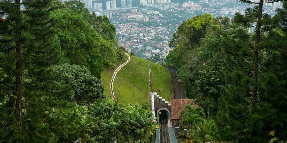 Shows the view from the top of Penang Hill
