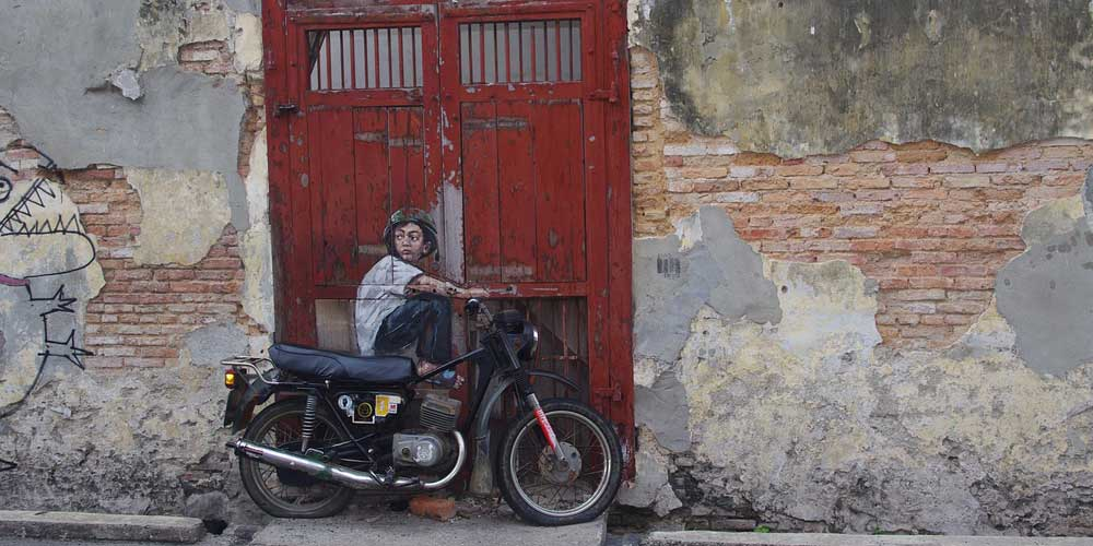 Shows a wall art centrepiece of a child on a motorbike