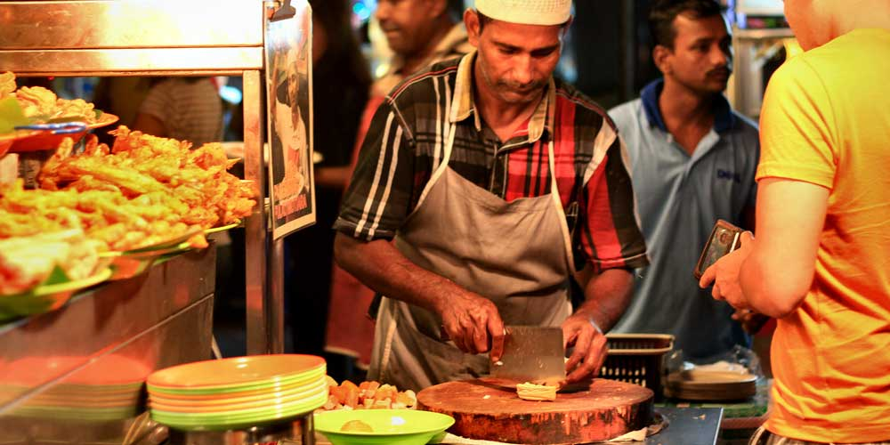 Shows a chef cooking Street Food