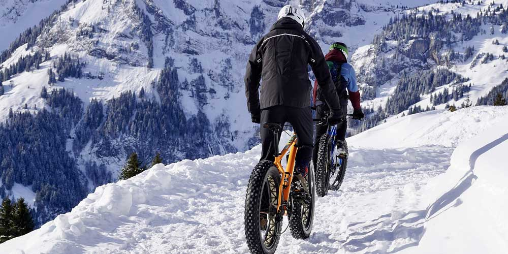 Cheapest way to book a holiday - Shows BMX riders on a mountain