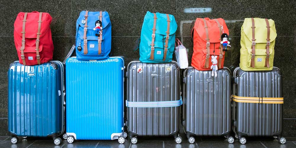 Holiday money and suitcase packing tips - Shows luggage
