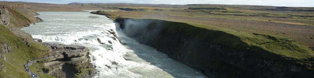 Iceland summer packing list - Shows a waterfall in the summer