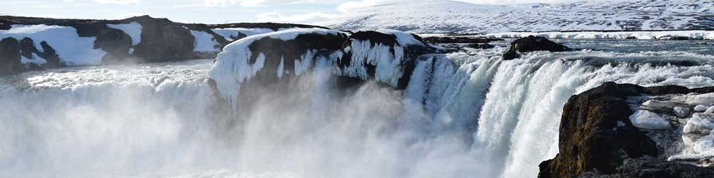 Iceland winter packing tips - Shows an icy waterfall