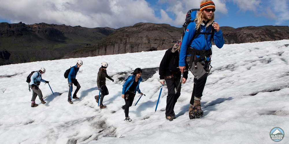 Adventurous things to do in Iceland - Shows a tour group climbing a glacier