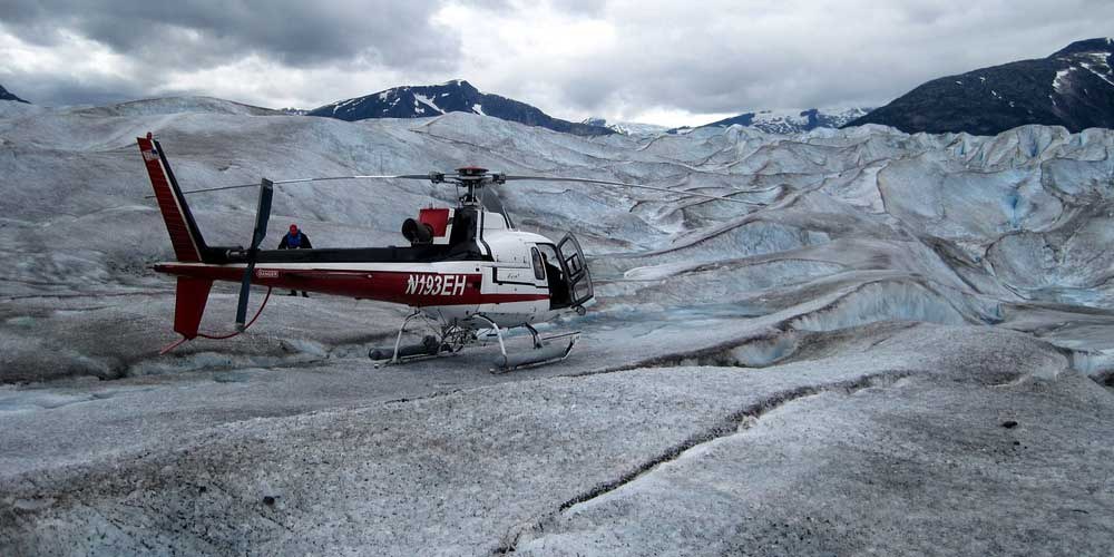 Shows a Helicopter on a glacier
