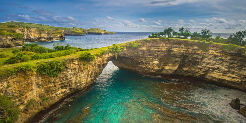 Shows Nusa Penida island and a turquoise lagoon