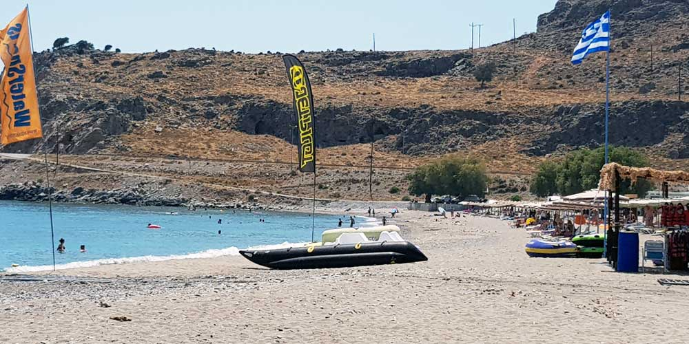 Shows a boat on the sand