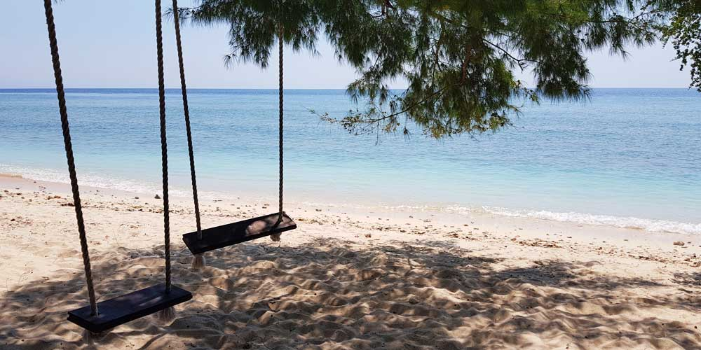 Gili Islands travel guide - Travel tips - Shows two beach swings