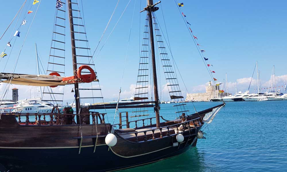 Shows an old ship by Rhodes Town harbour