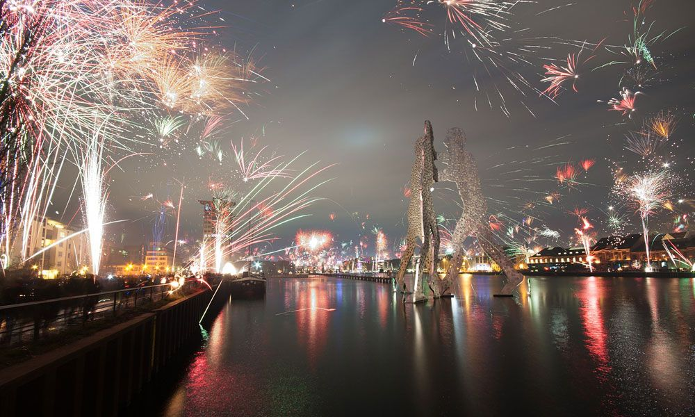 Shows a NYE firework display in Berlin - Where to go on holiday for new years eve