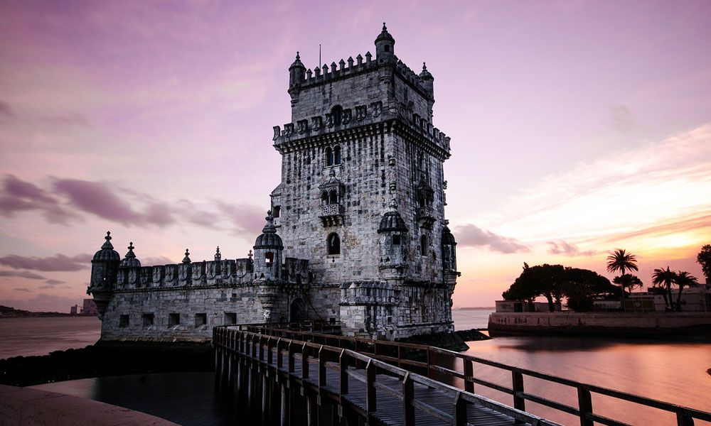 Shows Belem Tower at sunset