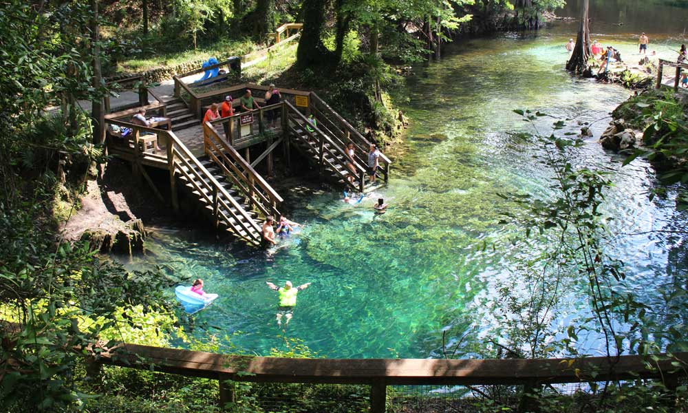 Blue Springs State Park day trips and excursions - depicts a turquoise natural lake