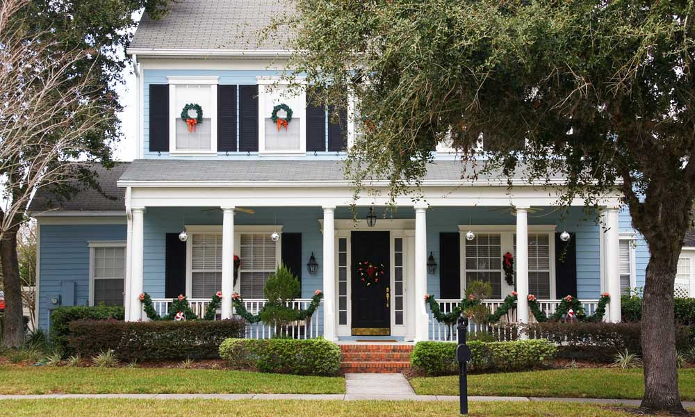 Celebration day trip - depicts a large American house with Christmas decorations