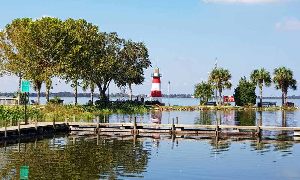 Mount Dora Day trips from Orlando - depicts Mt Dora lighthouse and lake