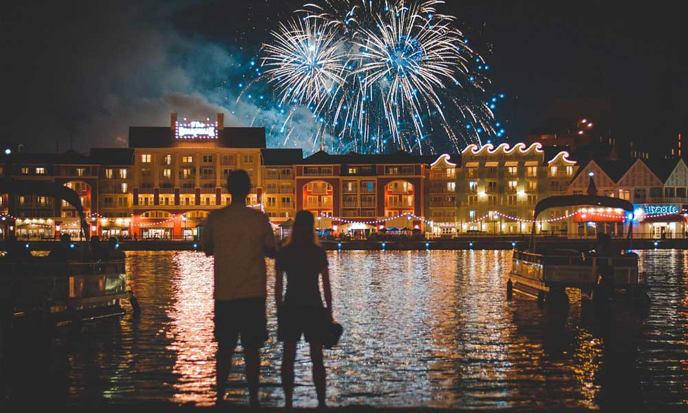 Depicts a couple watching the Disneyworld Fireworks - Couples' Orlando itinerary