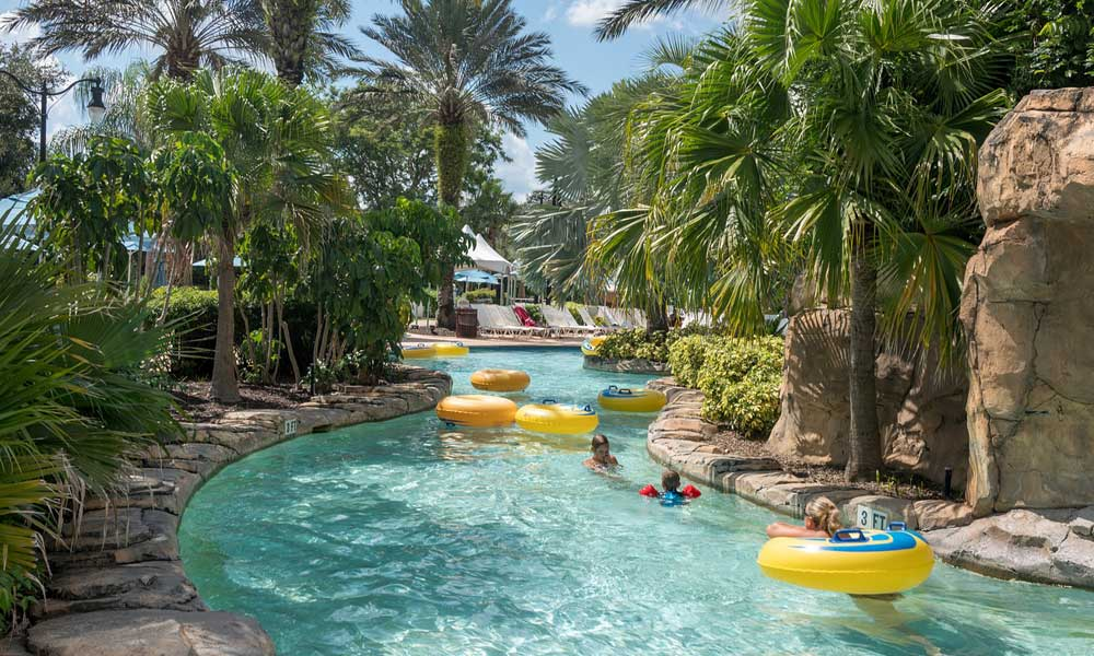 Depicts Disney Water Park Lazy River stream with palm trees - Orlando 2 week itinerary