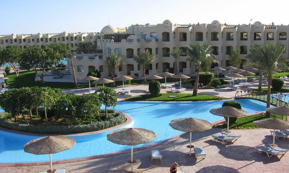 Hurghada beach resort with pool and palm trees - Where to go on holiday in March