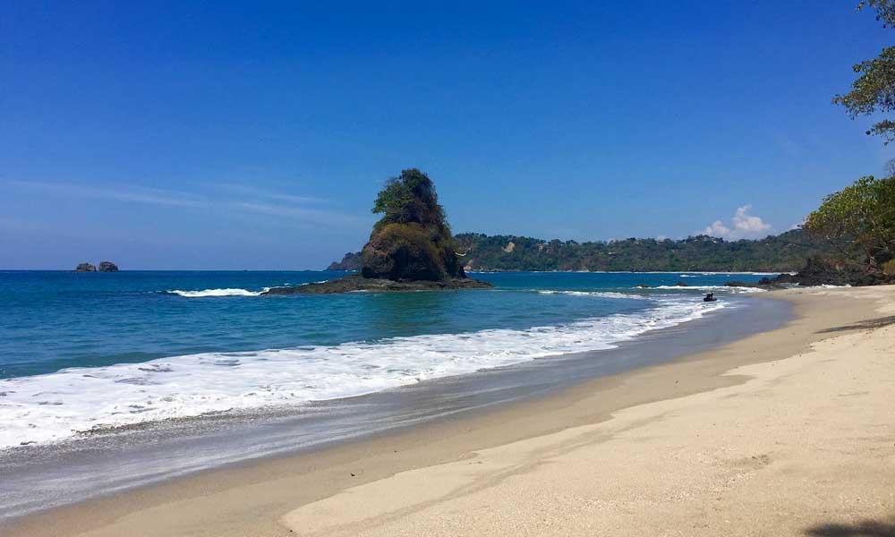 Remote beach in Costa Rica alongside a jungle