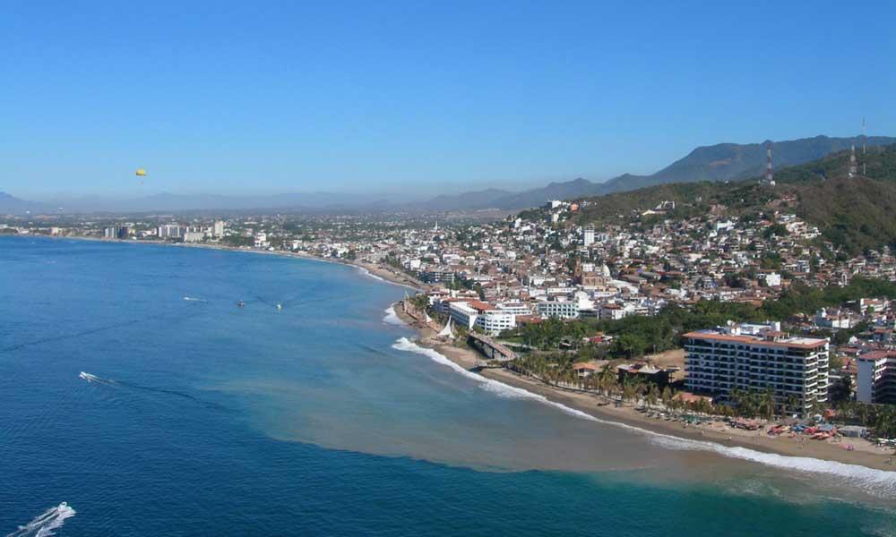 Puerto Vallarta coastline with blue ocean and pretty buildings