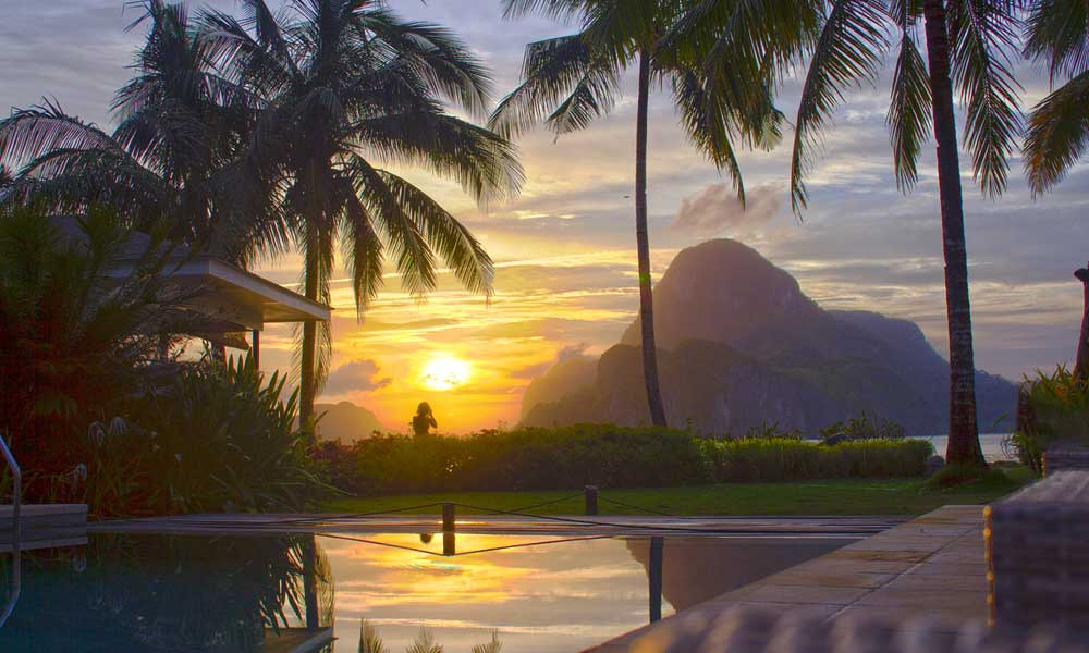 El Nido hotel overlooking the sunset and a mountain - March holiday ideas