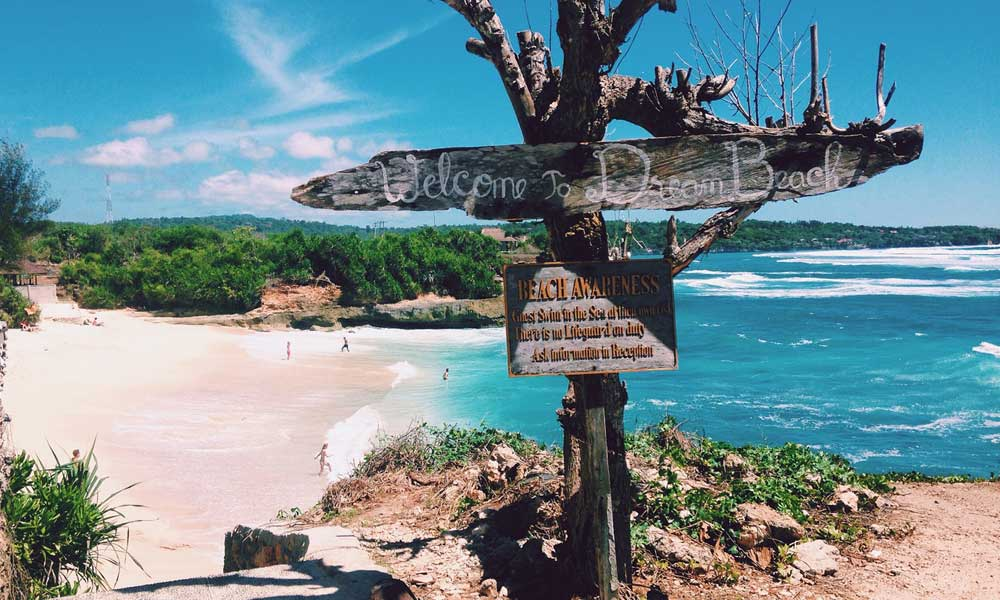 Where's hot in April - depicts Bali Dream Beach with a signpost