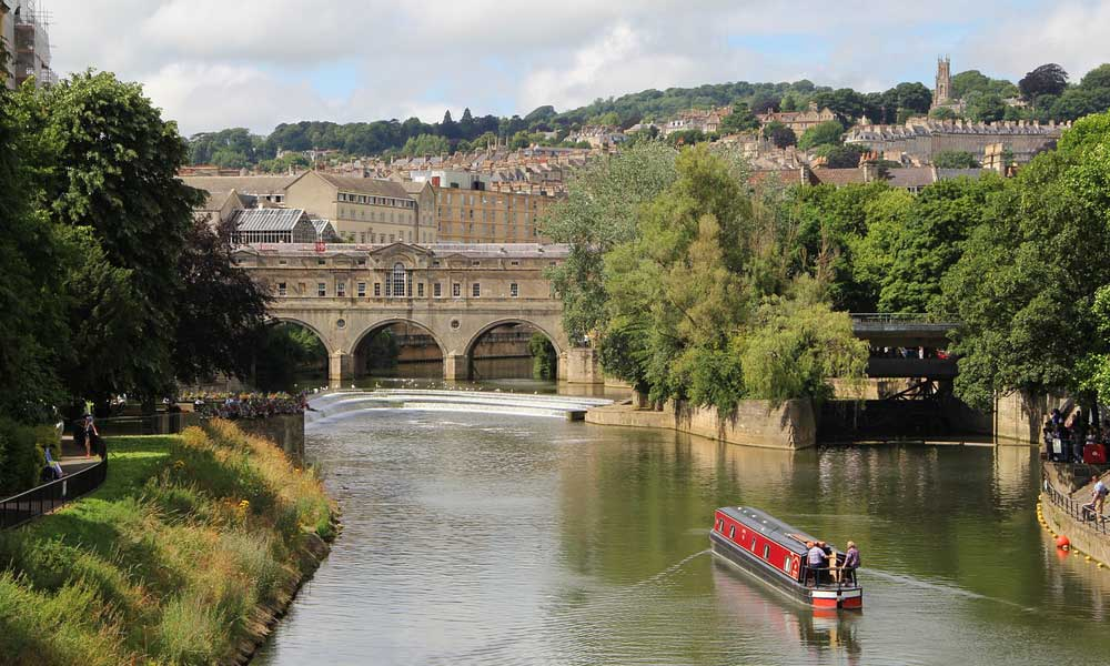 Best places to visit in the UK outside of London - depicts Bath river and buildings