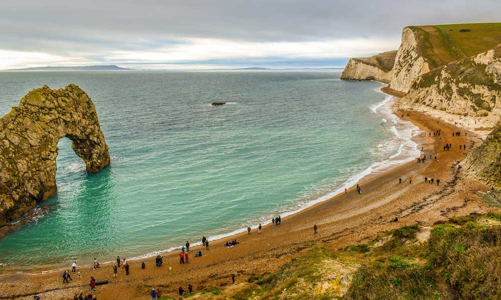 Depicts Jurassic coastline beaches in Dorset