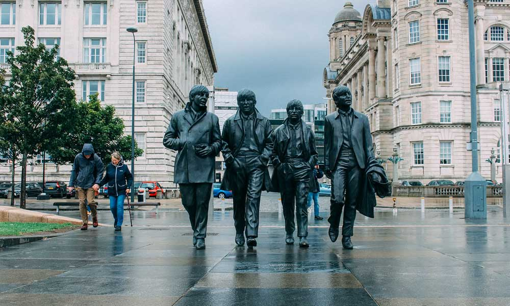 Depicts the Beatles statue in Liverpool city centre - the coolest UK cities