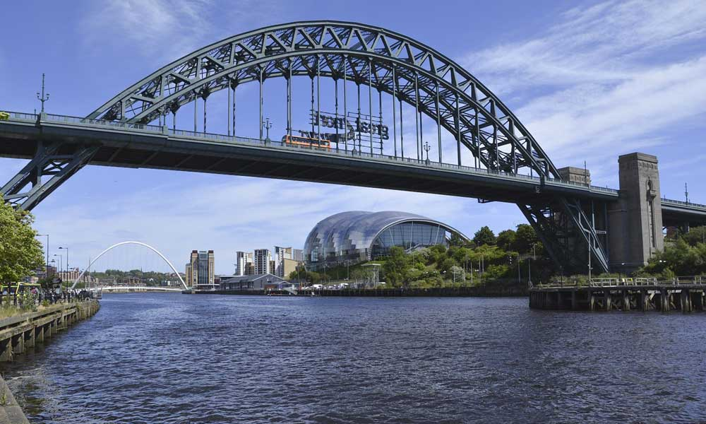 Depicts the River Tyne and Tyne Bridge in Newcastle - Best places to visit in the UK outside of London