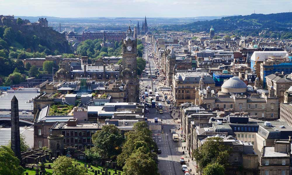 Depicts aerial view of Edinburgh city - Top UK cities