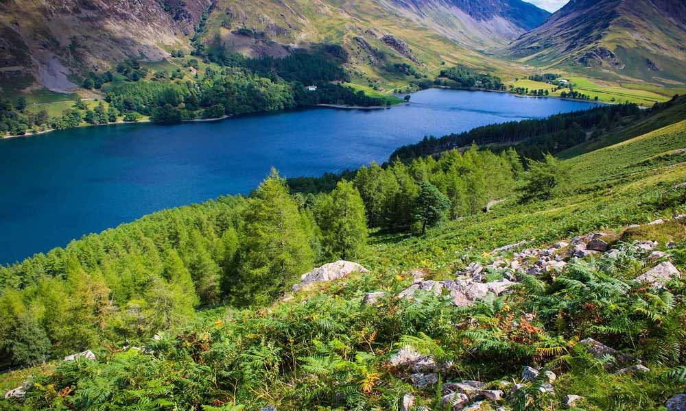 Depicts valleys and a lake in the Lake District  - Best places to visit in the UK outside of London