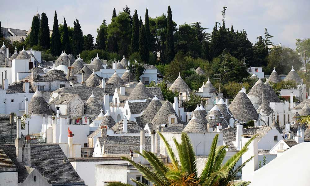Where to go on holiday in May - depicts Puglia Trulli Houses