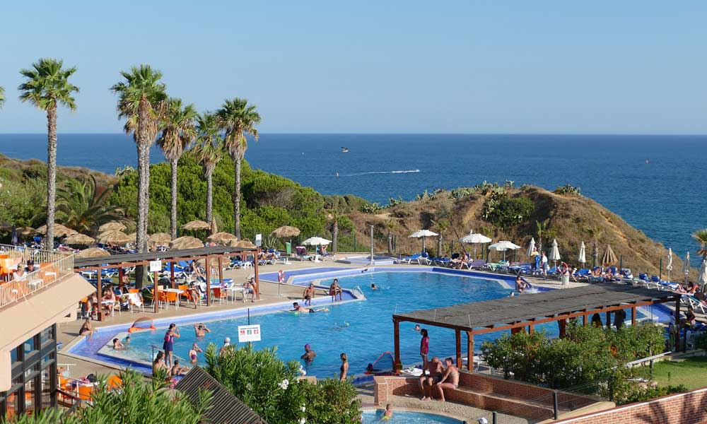 Depicts Albufeira cliffside resort - Best places to stay in Albufeira