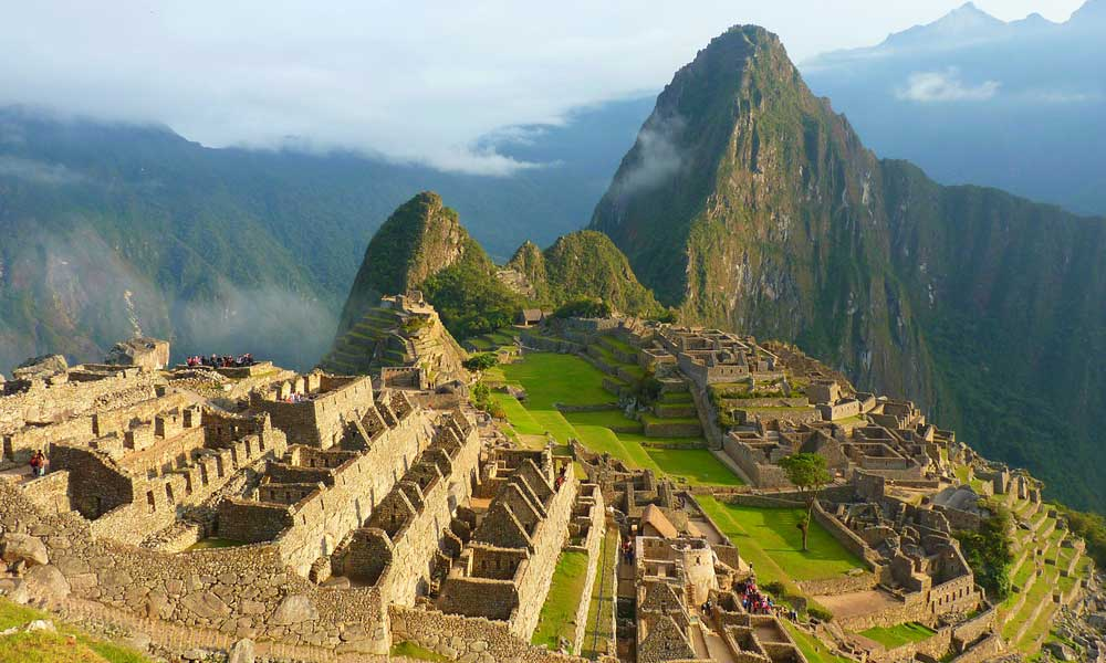 Depicts Inca Trail ruins in Peru - Adventure hiking holiday