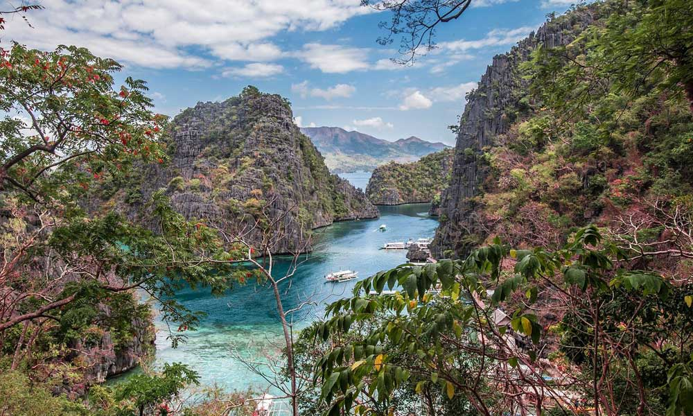 Adventure holiday destinations - Depicts mountain scenery of Palawan with ocean in distance
